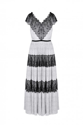 Romantic Dress made of delicate, crinkled white fabric with black dots.